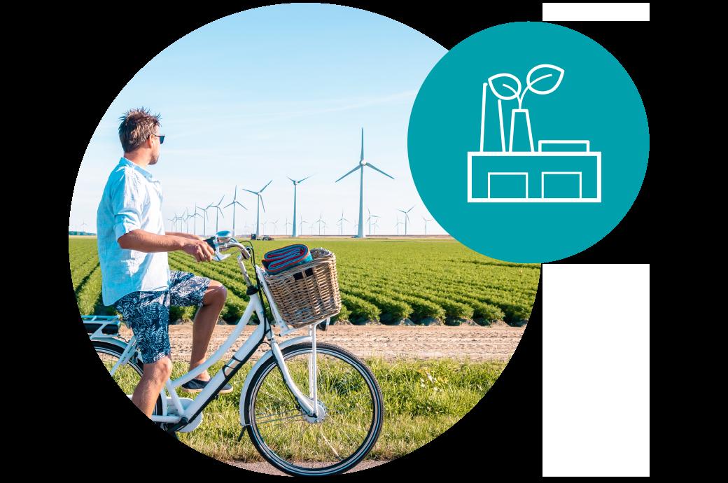 homem observando moinhos de vendo, usando energia limpa, reduzindo a pegada de carbono